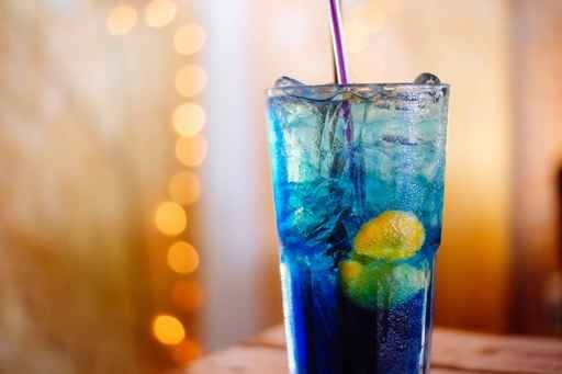 Blue liquid drink with ice
