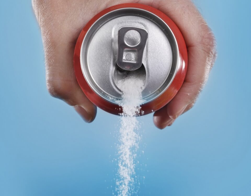 Sugar coming out from a poured Coke can.